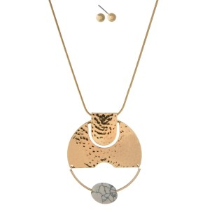 """Gold tone necklace set with a hammered circle pendant and white faceted bead. Approximately 32"""" in length."""