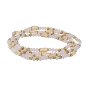 """Pink and gold tone bracelet that can also be worn as a necklace. Approximately 30"""" in length."""