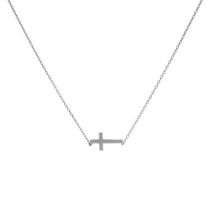 """Dainty silver tone necklace with an 8mm cross pendant. Length adjusts from 16""""-18""""."""