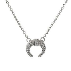 "Dainty silver tone necklace with a crescent pendant. Approximately 16"" in length."