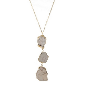 """Gold tone necklace featuring a three stone, ivory pendant. Approximately 30"""" in length."""