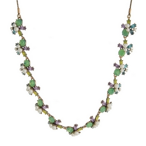 """Burnished gold tone necklace with mint green, purple and yellow rhinestones and pearl beads. Adjustable from 12"""" to 32"""" in length."""