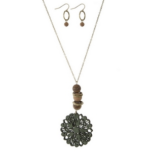 """Gold tone necklace set with a wooden, olive green, laser cut pendant and natural stone accents. Approximately 32"""" in length."""