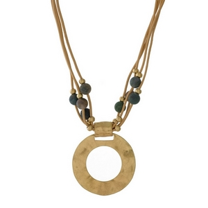 """Tan leather cord necklace with green natural stone beads and a gold tone circle pendant. Approximately 16"""" in length."""