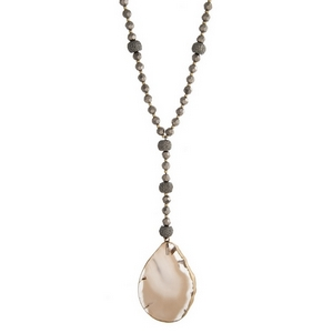 """Gold tone necklace with hematite faceted beads and a gray natural stone pendant. Approximately 36"""" in length."""