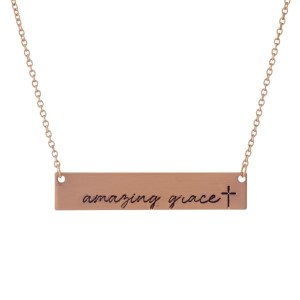 """Dainty rose gold tone necklace with a bar pendant, stamped with """"Amazing Grace."""" Approximately 16"""" in length."""