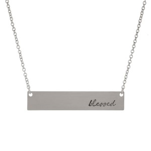 "Dainty silver tone necklace with a bar pendant, stamped with ""blessed."" Approximately 16"" in length."