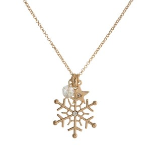 """Dainty metal necklace with a snowflake pendant and iridescent bead charm. Approximately 18"""" in length."""