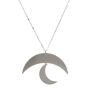 "Long, metal necklace with a moon pendant. Approximately 30"" in length."