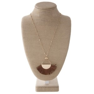 "Long gold tone necklace with faux leather fanned tassel pendant. Approximately 34"" in length with a 2x4"" pendant."