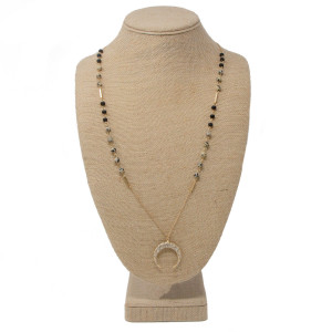 """Long beaded necklace with horn charm. Approximately 32"""" in length."""