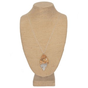 """Long necklace with cork pendant. Approximately 32"""" in length."""