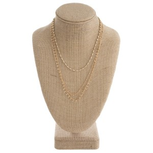 "Dainty layered metal necklace. Approximately 16-20"" in length."