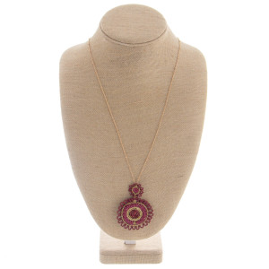 """Long metal necklace featuring a round seed beaded pendant. Approximate 32"""" in length with a 3"""" pendant."""
