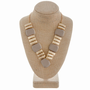 """Long V shaped necklace with wood and metal detail. Approximate 20"""" in length."""