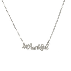 "Metal necklace with small ""#thankful"" pendant. Approximate 18"" in length with 1"" pendant."