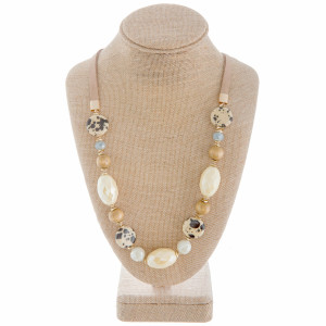 "Long faux leather necklace with natural stone and beads. Approximate 28"" in length."