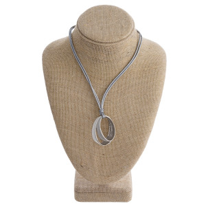 """Short layered leather necklace with metal  pendant. Approximate 12"""" in length."""