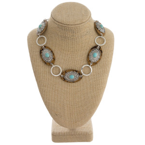 """Long metal linked necklace with natural stone and animal print details. Approximate 18"""" in length."""