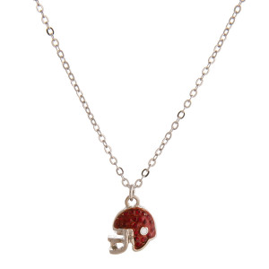 """Dainty cable chain necklace featuring a football helmet with cubic zirconia details. Pendant approximately 1cm. Approximately 18"""" in length overall."""