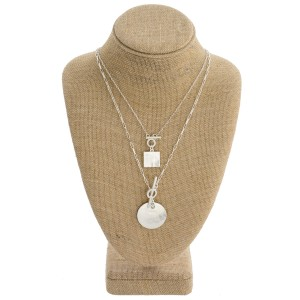 """Dainty layered chain linked geometric pendant necklace with double toggle clasp closure. Pendant approximately 1"""" in diameter. Approximately 20"""" in length overall."""