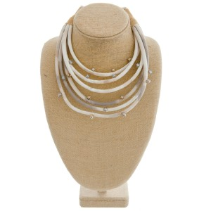 """Layered faux suede statement necklace with wire wrapped faceted bead accents.   - Shortest layer approximately 14"""" in length - Approximately 20"""" in length overall with 3"""" extender"""