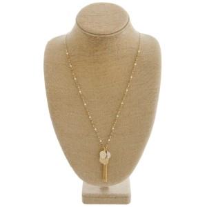 """Long pearl beaded necklace featuring a chain linked charm tassel pendant.  - Pendant approximately 3"""" in length - Approximately 36"""" in length overall"""