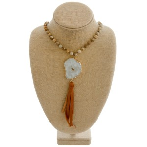 """Semi precious beaded faux leather necklace featuring a druzy tassel pendant.   - Druzy varies in size - Pendant approximately 8.5"""" in length - Approximately 44"""" in length overall"""