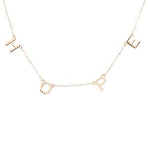 """Hope"" Floater Necklace in Gold.  - Approximately 16"" L  - Adjustable 3.5"" Extender"