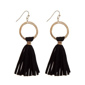 "Gold tone fishhook earrings displaying a circle and a black suede tassel. Approximately 3"" in length."