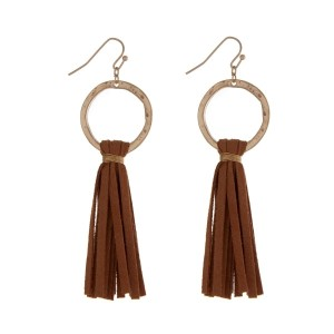 "Gold tone fishhook earrings displaying a circle and a cognac suede tassel. Approximately 3"" in length."