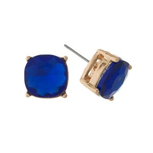 """Gold tone stud earrings with a royal blue rhinestone. Approximately 1/2"""" in width."""