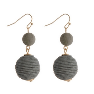 """Gold tone fishhook earrings featuring a gray natural stone and a gray thread wrapped ball. Approximately 1.5"""" in length."""