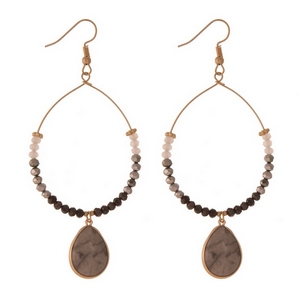 """Gold tone fishhook earrings with black faceted beads and a labradorite sodalite natural stone. Approximately 3.5"""" in length."""