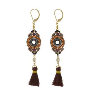 "Gold tone lever-hook earrings with a beaded circle shape and a thread tassel. Approximately 3.25"" in length. Handmade in the USA."