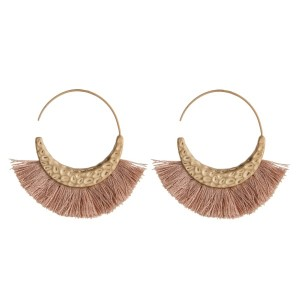 "Hammered gold tone hoop earring with fanned, soft tassel. Approximately 1.5"" in length."