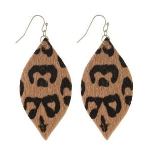 "Long fishhook earrings with oval leopard print design. Approximately 2"" in length."