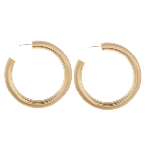 """Chunky metal hoop earring with 1/4"""" thickness and a 2"""" diameter."""