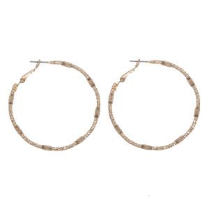 """Hammered metal hoop earring. Approximately 1.5"""" diameter."""