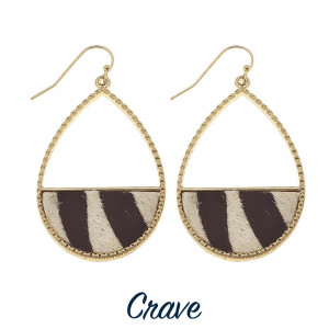 Long drop earrings with a zebra print pattern and gold trim.