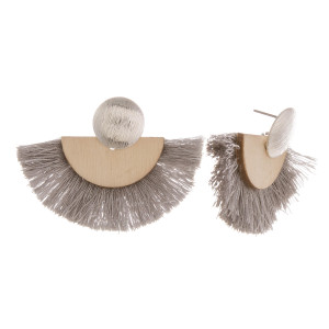 """Short earrings with gold metal posts, wood details, and soft tassels. Approximately 1"""" in length."""