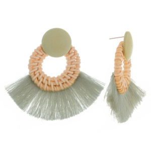 """Long woven raffia hoop earrings with wood post and soft tassel. Approximately 2"""" in length."""