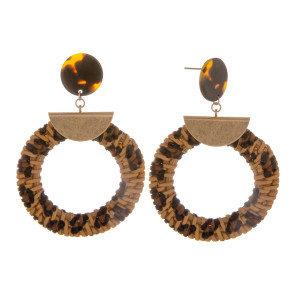 "Long straw hoop earring with tortoise post and animal print details. Approximate 2.5"" in length."