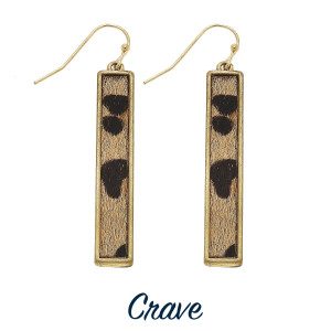"Leopard print vertical bar earrings. Approximately 1.5"" long."