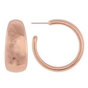 """Long open hoop earring. Approximate 1.5"""" in length."""