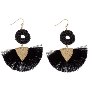 "Long fishhook earrings with woven raffia and tassel details. Approximately 3"" in length."