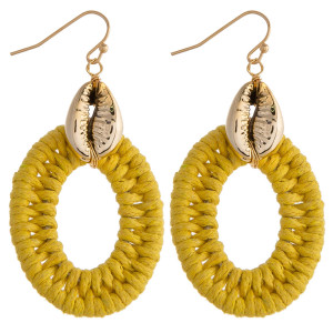 """Long rattan wrapped earrings featuring a gold puka shell detail. Approximately 2"""" in length."""