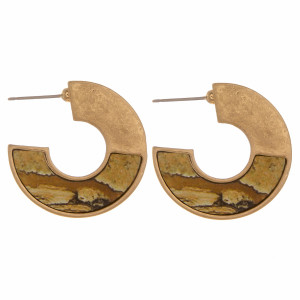 """Metal hoop earrings featuring a wood natural stone inspired pattern. Measure approximately 1"""" in length."""