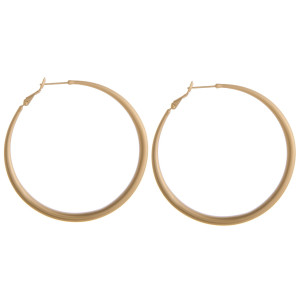 "Large metal hoop earrings. Approximately 2"" in diameter."