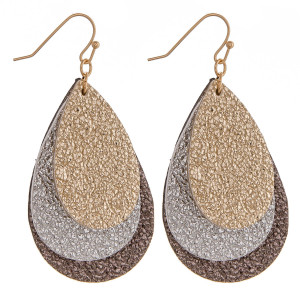 """Faux leather earrings featuring trio two tone metallic teardrop accents. Approximately 2"""" in length."""